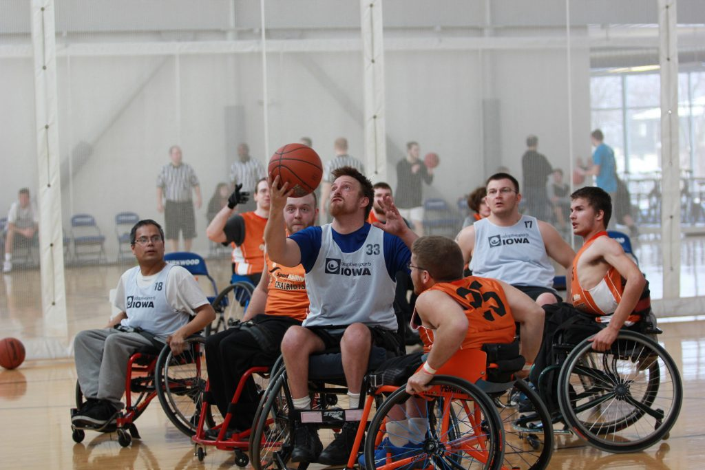 Two teams playing wheelchair basketball