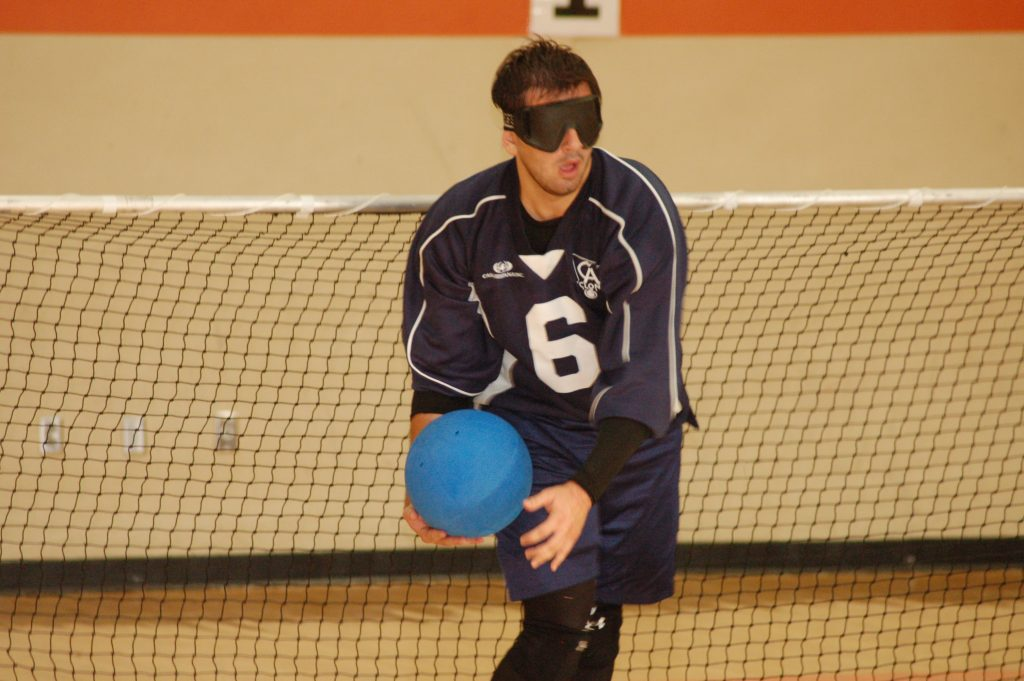 Man rolling goalball