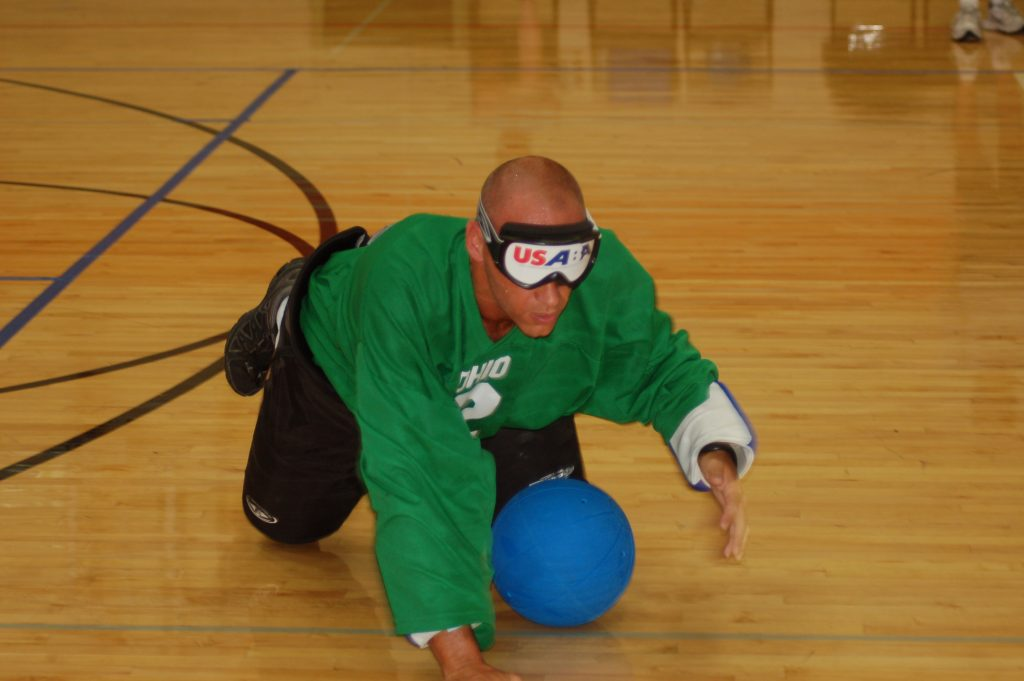 Man crawling while playing Goalballl